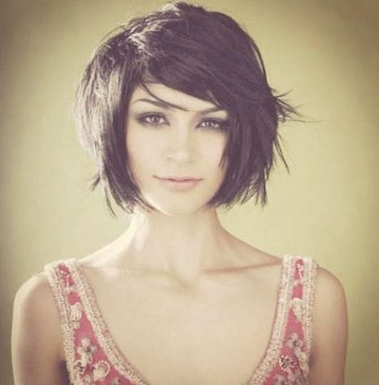 Around Chin Length, Razored/textured Bob With Side Swept Bangs For Bob Haircuts With Bangs For Thick Hair (View 12 of 15)