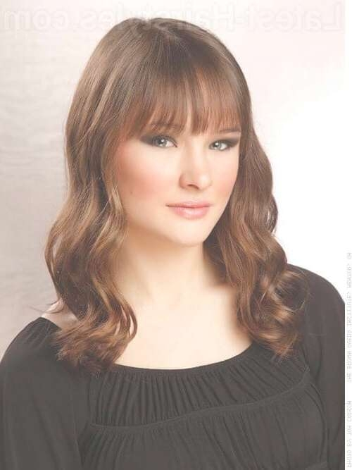 28 Effortlessly Chic Medium Length Wavy Hairstyles Regarding Recent Curly Medium Hairstyles With Bangs (View 13 of 25)