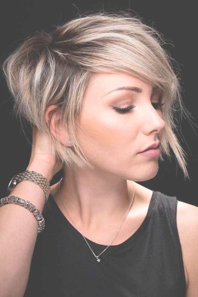 Best 25+ Short Asymmetrical Hairstyles Ideas On Pinterest | Pixie In Most Recently Symmetrical Medium Haircuts (View 19 of 25)
