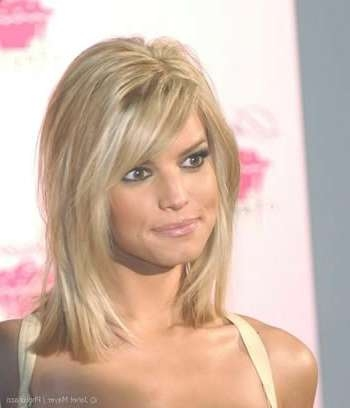 Best Hairstyles For Oval Faces 2013: Medium Hairstyles With Bangs Regarding Most Popular Medium Hairstyles With Bangs For Oval Faces (View 16 of 25)