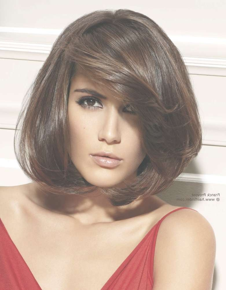 Brown Bob Hairstyle With Volume And A Diagonal Fringe With Regard To Latest Volume Medium Hairstyles (View 25 of 25)