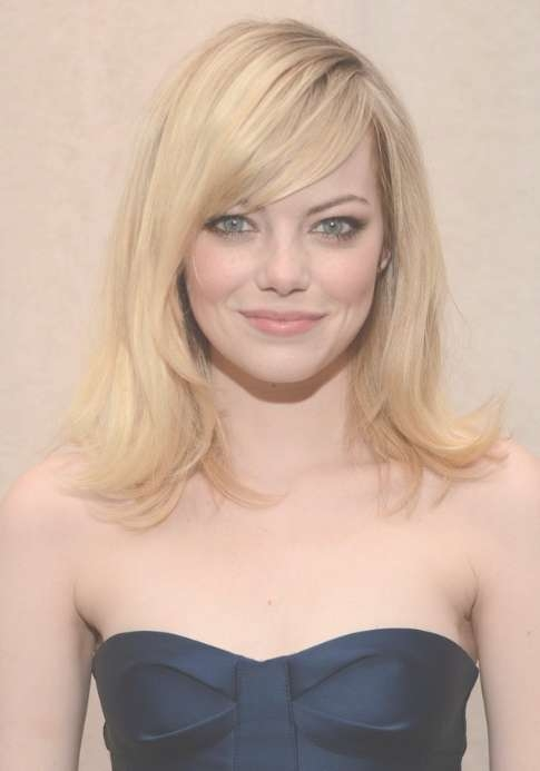 Emma Stone Layered Medium Length Hairstyle With Side Swept Bangs Intended For Most Recently Medium Haircuts With Layers And Side Bangs (View 12 of 25)