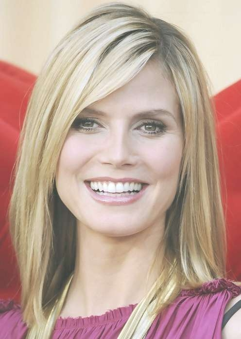 Heidi Klum Medium Length Hairstyle: Straight Haircut With Side In Newest Medium Medium Haircuts With Side Bangs (View 6 of 25)