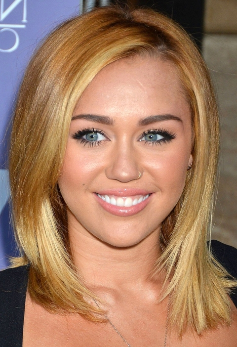 Miley Cyrus Medium Haircuts With Long Side Bangs Pertaining To Most Up To Date Medium Hairstyles With Long Side Bangs (View 7 of 25)