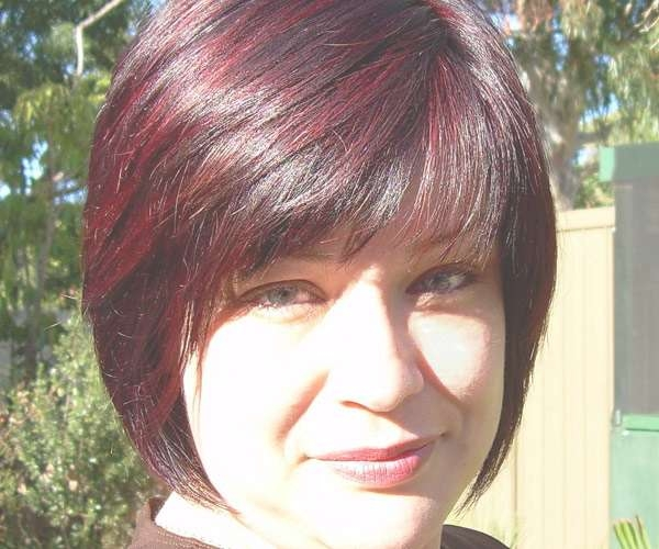 Silky Black Bob Cut Hairstyle Red Highlights Has Pointed | Medium Throughout Current Medium Hairstyles With Red Highlights (View 15 of 15)