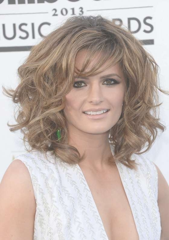 Stana Katic Layered Medium Curly Hairstyle With Bangs For Thick With Latest Curly Medium Hairstyles With Bangs (View 9 of 25)