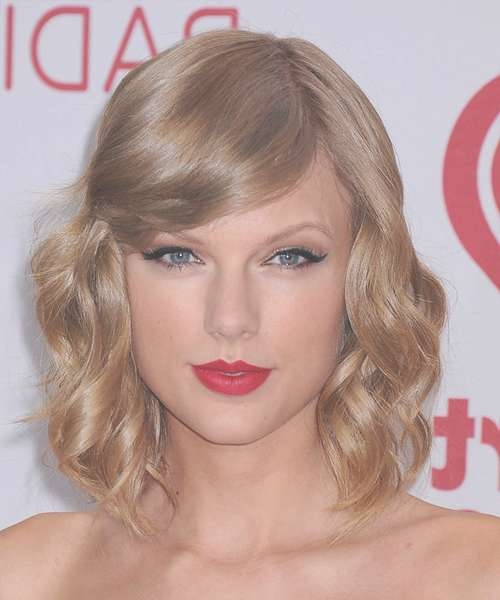Taylor Swift Medium Wavy Formal Hairstyle With Side Swept Bangs Pertaining To Best And Newest Taylor Swift Medium Hairstyles (View 20 of 25)