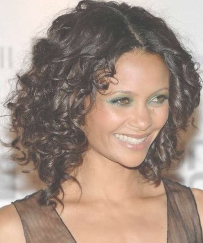 Top 20 Medium Length Hairstyles With Bangs For Round Faces Regarding Newest Curly Medium Hairstyles For Round Faces (View 13 of 25)