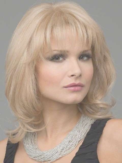 Trendy Medium Length Hairstyles For Round Faces – Pictures & Tips In Most Recently Medium Hairstyles For Women With Round Faces (View 21 of 25)