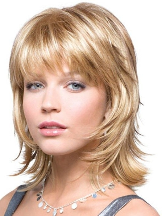 Medium Length Layered Hairstyles Appear In Various Appearances With Most Up To Date Medium Shaggy Hairstyles With Bangs (View 9 of 15)