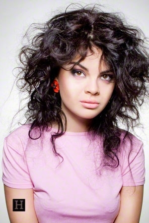 Women's Medium Length Curly Shag Hairstyle, With Warm Black Hair Pertaining To Recent Medium Shaggy Hairstyles For Curly Hair (View 3 of 15)