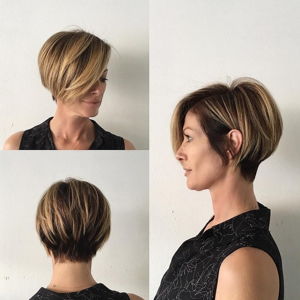 Women's Short Blonde Highlighted Bob With Stacked Layers And Long With Regard To Most Recently Pixie Hairstyles With Long Side Swept Bangs (View 12 of 15)