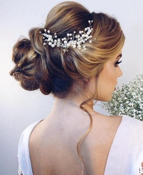 40 Chic Wedding Hair Updos For Elegant Brides | Bridal Bun, Weddings In Most Recently Bridal Bun Updo Hairstyles (View 9 of 15)