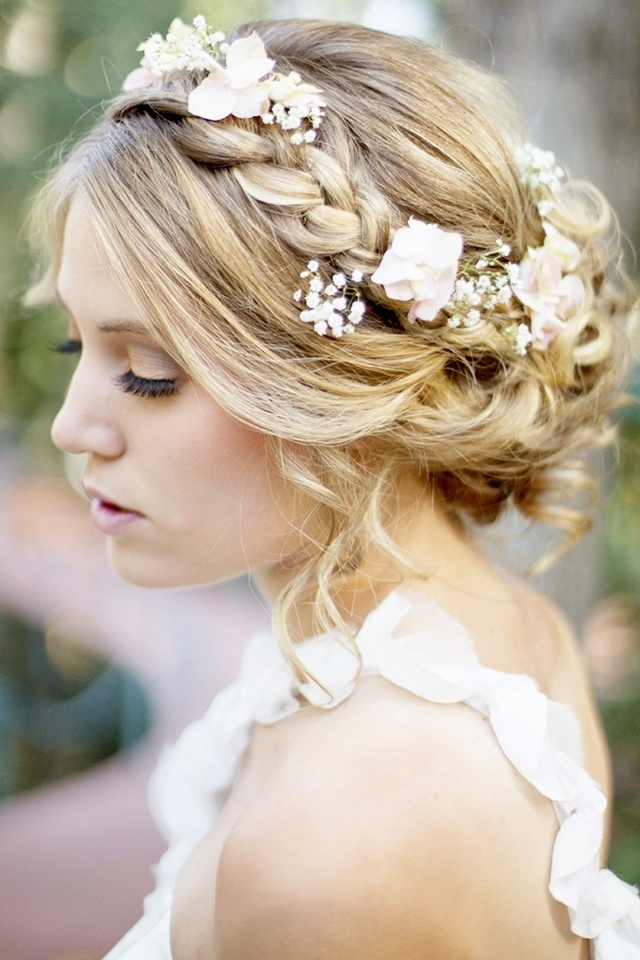 Braided Crown Hairstyle For Wedding Day With Flowers And Low Bun Regarding Current Updo Hairstyles With Flowers (View 5 of 15)