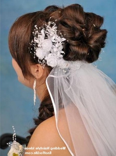 Loopy Bun Wedding Hairstyle With Veil – Knot For Life With Newest Wedding Updo Hairstyles With Veil (View 13 of 15)
