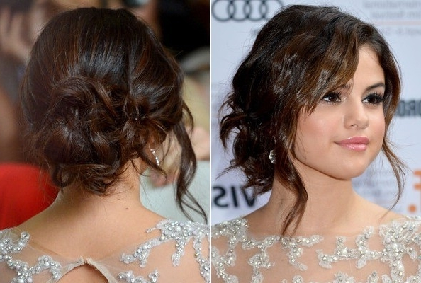 Selena Gomez's Wavy, Loose Bun – The Prettiest Celeb Inspired Prom Inside Most Recently Loose Bun Updo Hairstyles (View 9 of 15)