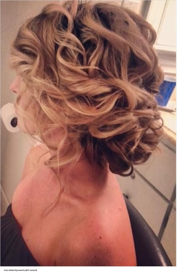 Top 12 Messy Bun Hairstyles For The Curly Hair For 2018 Messy Bun Updo Hairstyles (View 5 of 15)