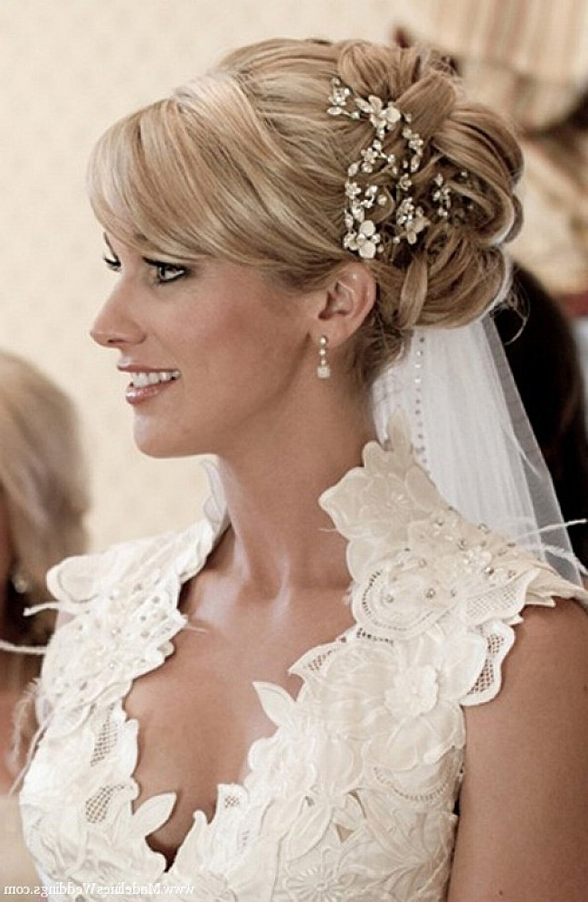 Wedding Bun Hairstyles For Long Hair With Side Bangs And Veil | Hair Intended For Most Popular Wedding Updo Hairstyles With Veil (View 5 of 15)