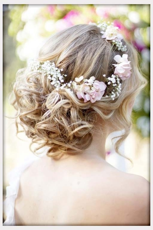 Wedding Flowers, Wavy Curly Updo Wedding Hairstyle With Flower Crown Pertaining To Most Up To Date Updo Hairstyles With Flowers (View 3 of 15)