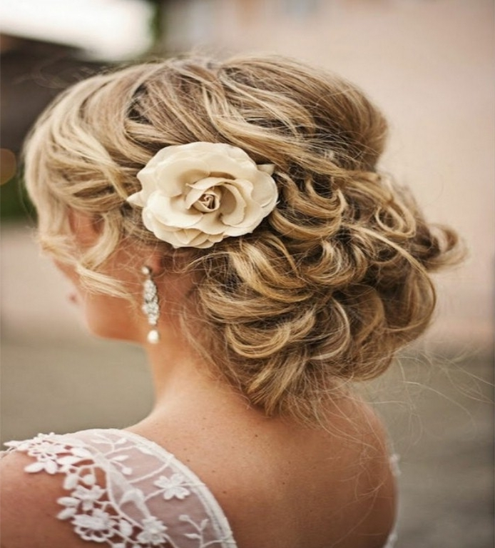 Wedding Hairstyles Ideas: Low Bun Updo Hairstyles For Curly Hair For Recent Low Bun Updo Hairstyles For Wedding (View 15 of 15)