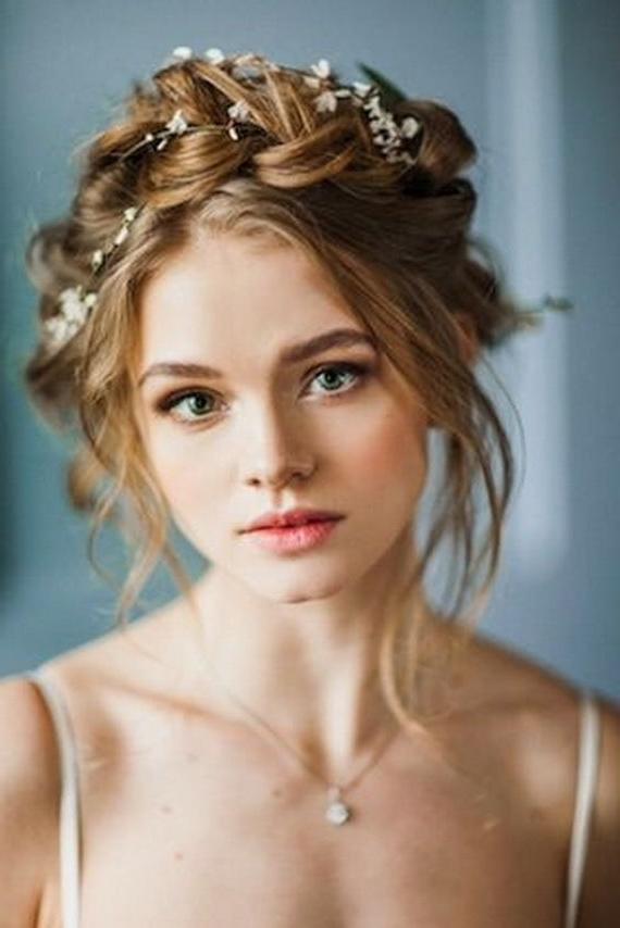 10 Flower Crown Hairstyles For Any Bride – Mywedding Inside Tiara Wedding Hairstyles (View 10 of 15)