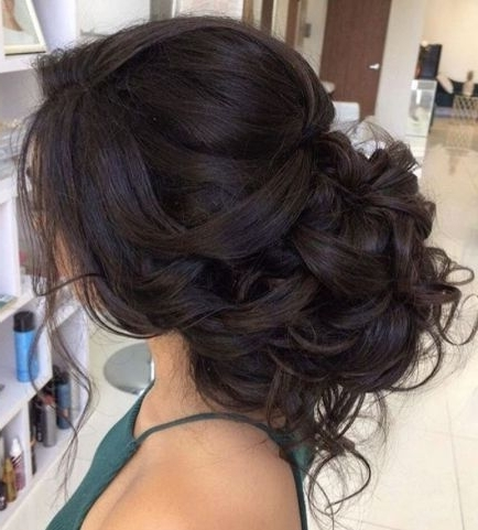 Classic Loose Curly Low Updo Wedding Hairstyle; Featured Hairstyle Intended For Low Updo Wedding Hairstyles (View 3 of 15)