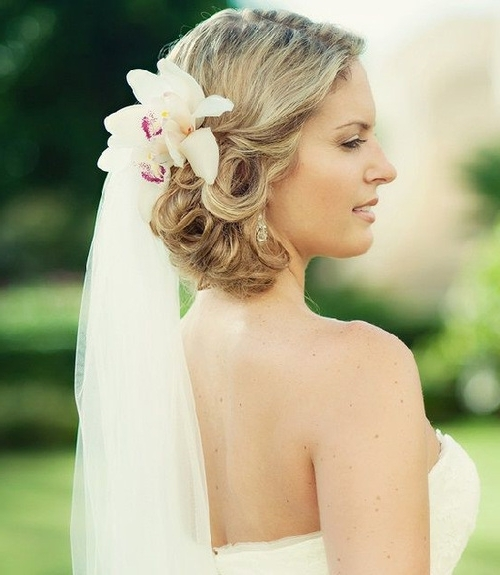 Gorgeous Hairstyles Of Brides With Veil | Weddings Eve Within Wedding Hairstyles With Veil And Flower (View 4 of 15)
