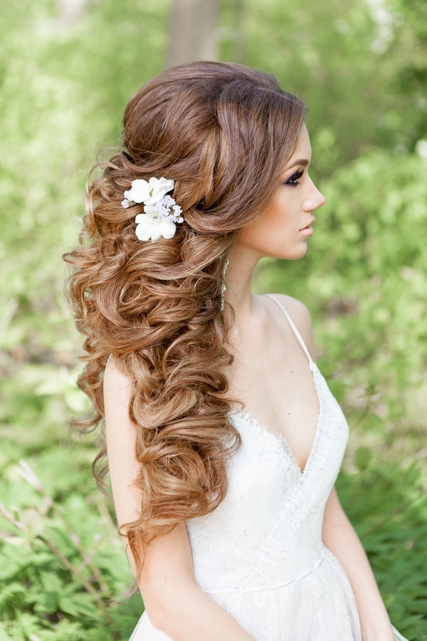 Half Up Half Down Curly Hairstyle With Flowers Picture | Deer Pearl With Half Up Wedding Hairstyles Long Curly Hair (View 11 of 15)