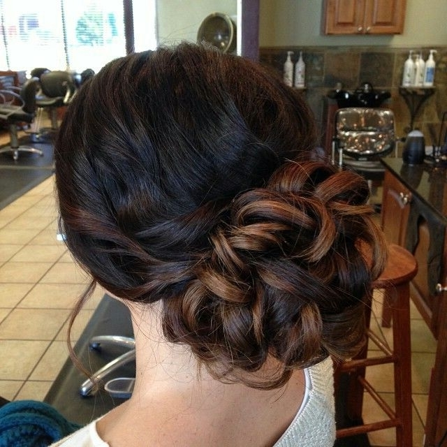 Loose Curls Put Up In A Bun Updo (View 3 of 15)