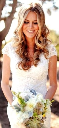 Photo Via | Bridal Flowers, Fascinator And Jewelry Accessories Intended For Middle Part Wedding Hairstyles (View 6 of 15)
