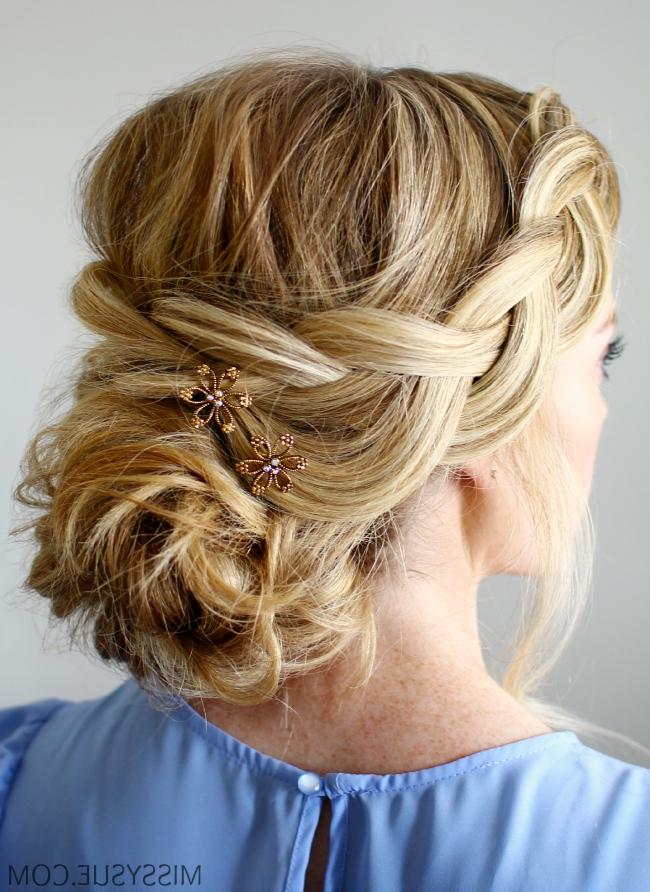 Wispy Braid And Low Bun Throughout Plaits Bun Wedding Hairstyles (View 9 of 15)