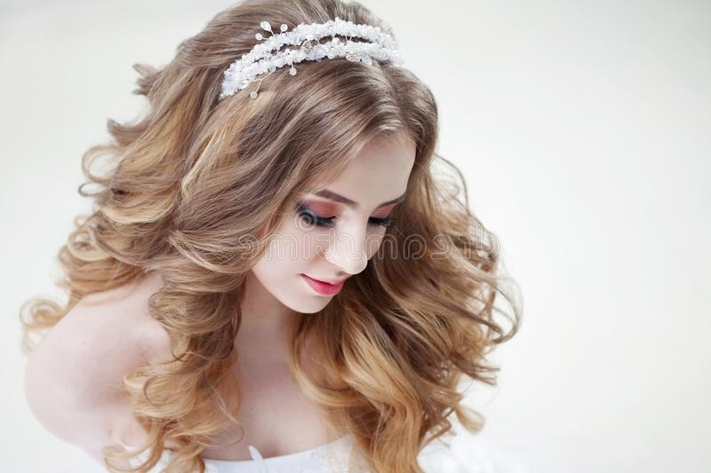 Young Beautiful Bride With Luxurious Curls (View 11 of 15)
