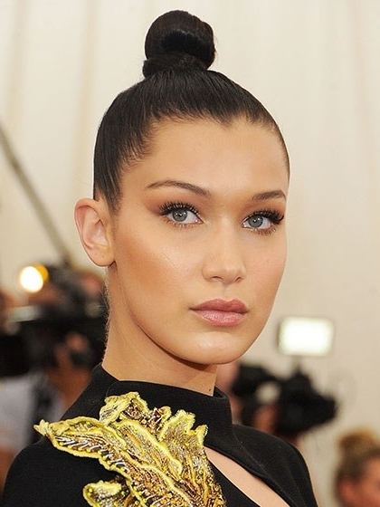 10 Ways To Update Your Bun This Season | Allure Regarding Newest Top Knot Bun With Cascade Of Thin Braids (View 14 of 15)