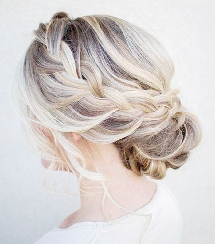 10 Wedding Updos That Are Actually Cool | Byrdie Pertaining To Most Up To Date Updo With Forward Braided Bun (View 13 of 15)