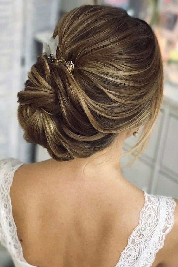 25 Chic Updo Wedding Hairstyles For All Brides Inside Latest Updo With Forward Braided Bun (View 12 of 15)