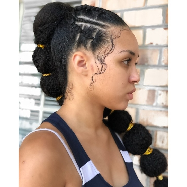 Afro Puff Bubble Ponytails Are Trending On Instagram | Allure Intended For Most Recent Crossed Twists And Afro Puff Pony (View 14 of 15)