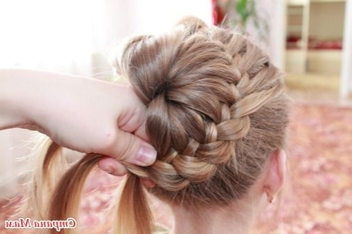 Diy Unique Braided Bun Hairstyle In Most Recent Donut Bun Hairstyles With Braid Around (View 9 of 15)