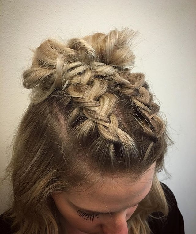 Double Dutch Braids Finished Into Buns For This Cute Concert Goer Pertaining To 2018 Messy Flipped Braid And Bun Hairstyles (View 9 of 15)