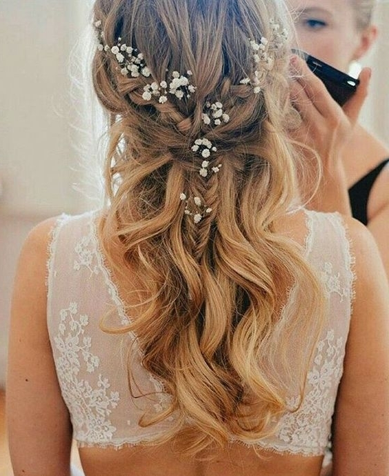 Picture Of A Half Updo With A Braid And Waves And Some Baby's Breath Regarding Best And Newest Half Updo Braids Hairstyles With Accessory (View 11 of 15)