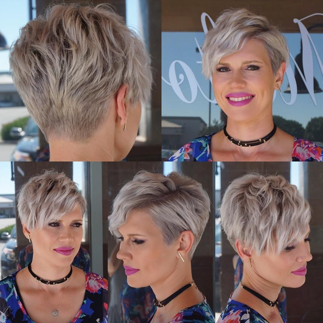 This Wavy Platinum Blonde Textured Pixie Crop With Side Swept Bangs For Best And Newest Platinum Blonde Disheveled Pixie Haircuts (View 11 of 15)
