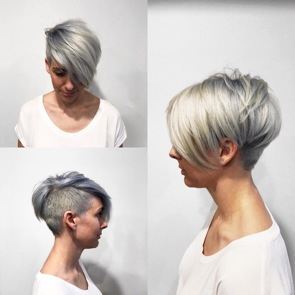 Women's Textured Platinum Undercut Pixie With Long Side Swept Bangs Throughout Most Current Long Tapered Pixie Haircuts With Side Bangs (View 5 of 15)