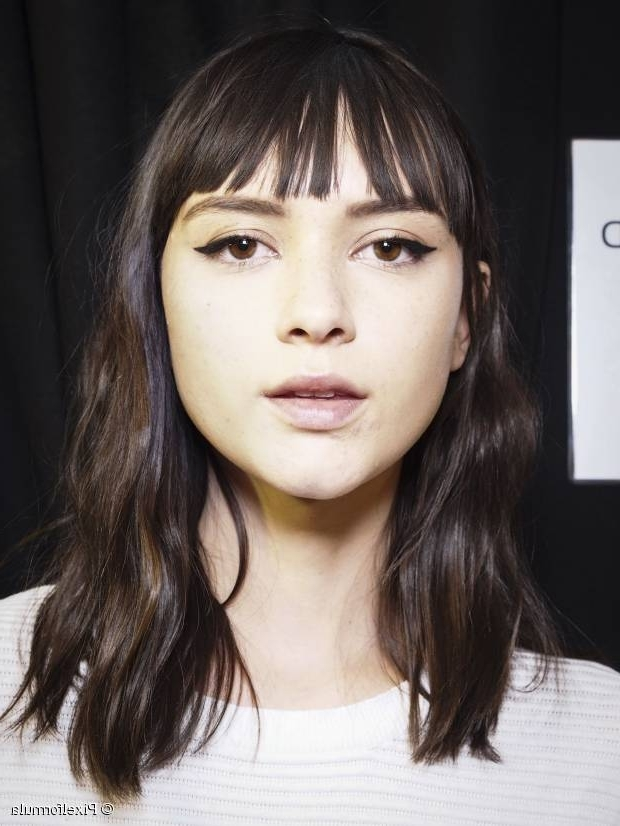 10 On Trend Hairstyles With Bangs Regarding Accessorize Curled Look Ponytail Hairstyles With Bangs (View 19 of 25)