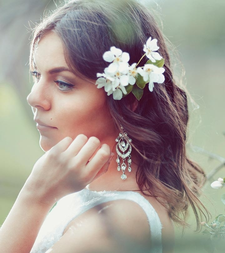 13 Most Popular Hairstyles For Reception Inside Classy Flower Studded Pony Hairstyles (View 2 of 25)