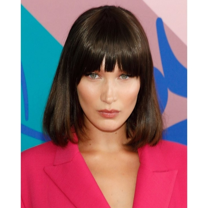 15 Best Hairstyles With Bangs – Ideas For Haircuts With Bangs | Allure Throughout Weaved Polished Pony Hairstyles With Blunt Bangs (View 8 of 25)