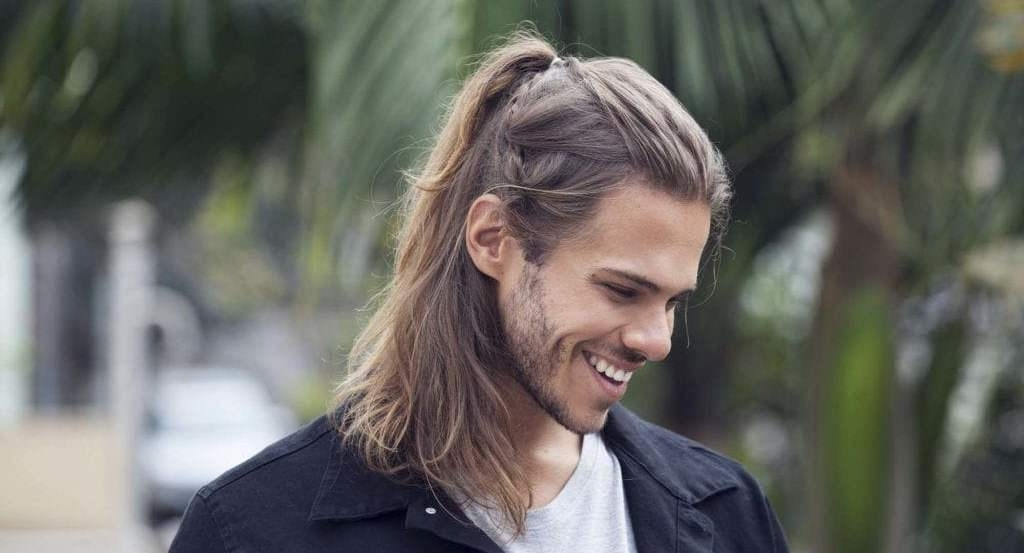 15 Ponytail Hairstyles For Men To Look Smart And Stylish – Haircuts Inside Asymmetrical Curly Ponytail Hairstyles (View 21 of 25)