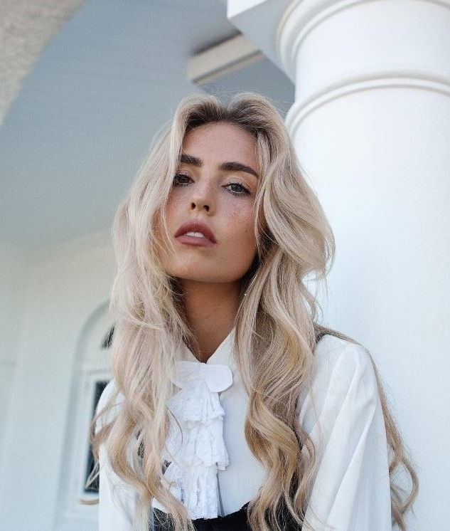 22 Long Blonde Hair Ideas That'll Make You Feel Like A Bombshell With Simple Blonde Pony Hairstyles With A Bouffant (View 7 of 25)