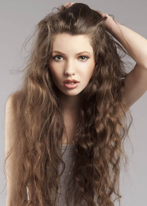 25 Cutest Long Curly Hairstyles For 2018 Within Curly Pony Hairstyles For Ultra Long Hair (View 6 of 25)
