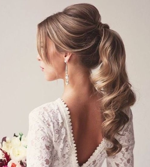 30 Eye Catching Ways To Style Curly And Wavy Ponytails Within Poofy Ponytail Hairstyles With Bump (View 6 of 25)