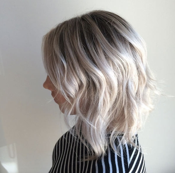 50 Enviable Platinum Blonde Hairstyles That Just Might Inspire You With Pearl Blonde Bouncy Waves Hairstyles (View 10 of 25)
