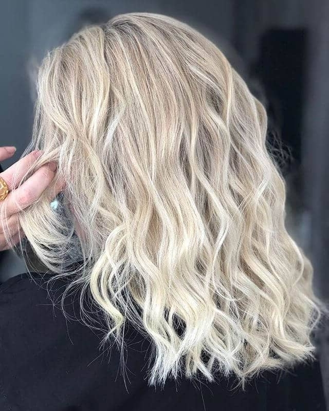 50 Platinum Blonde Hairstyle Ideas For A Glamorous 2018 In Casual Bright Waves Blonde Hairstyles With Bangs (View 16 of 25)